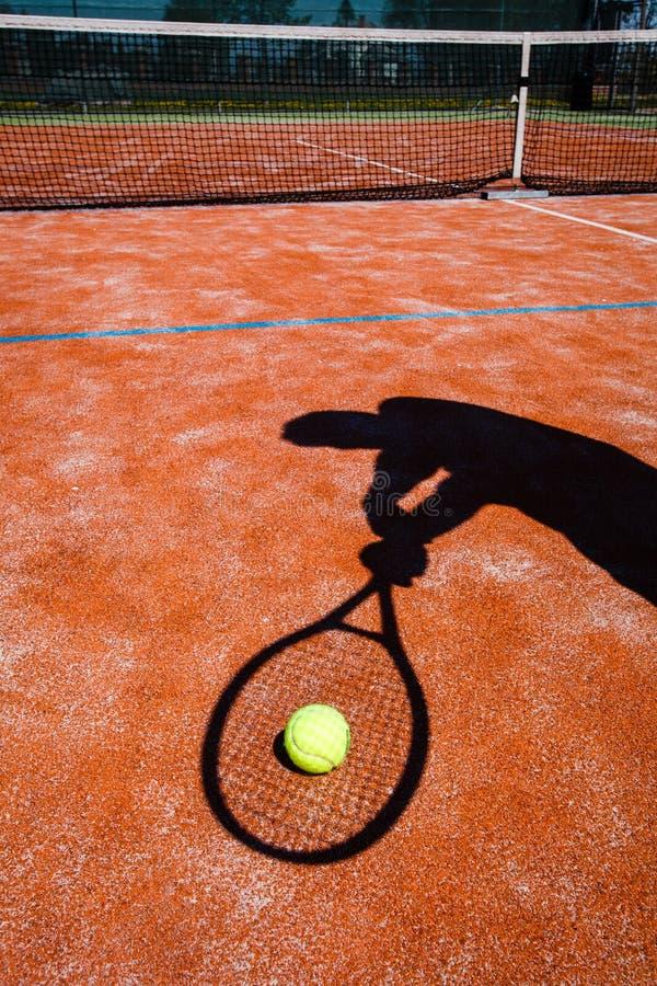 Schaduw van een tennisspeler in actie royalty-vrije stock fotografie