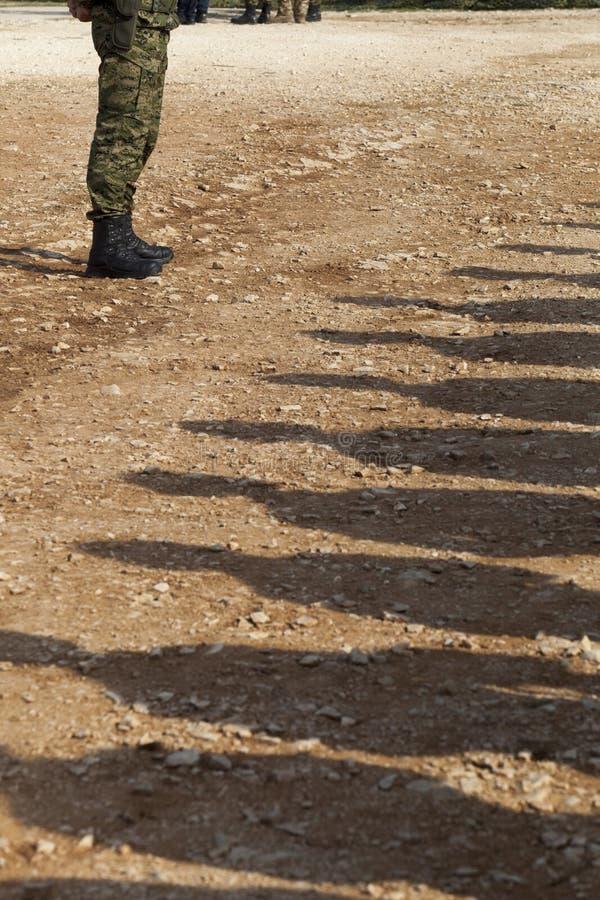 Schaduwen van militairen stock foto's