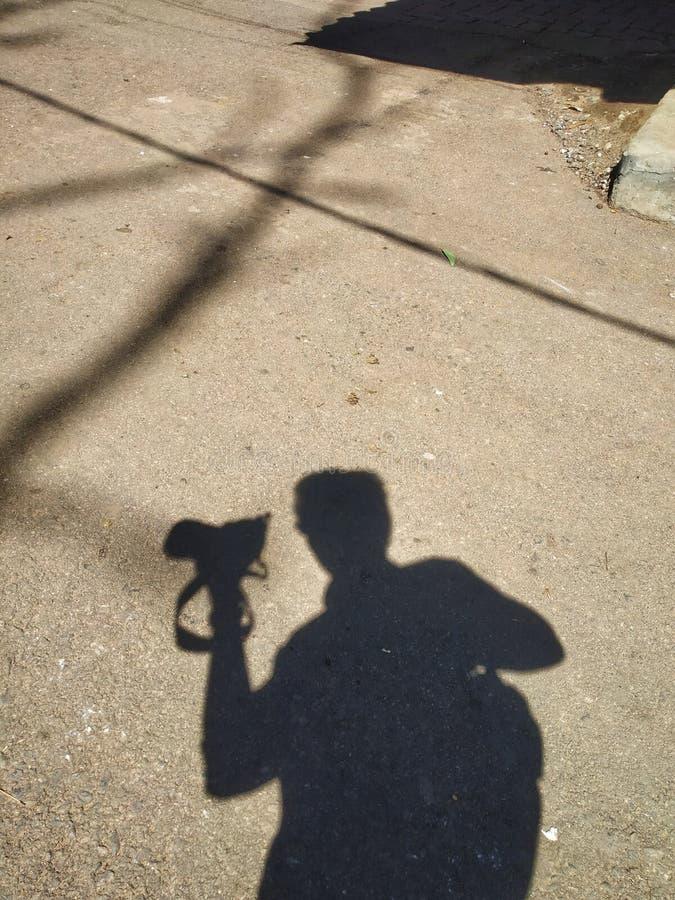 Schaduwfotograaf stock foto