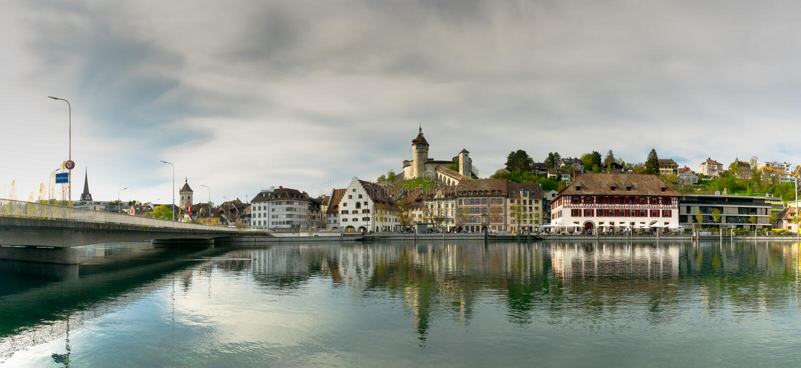 Schaffhausen, SH / Switzerland - 22 April 2019: view of the city of Schaffhausen with the bridge across the Rhine and city limits. Sign stock photography