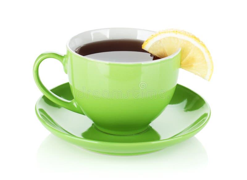Schale des grünen Tees mit Zitronenscheibe stockfotografie