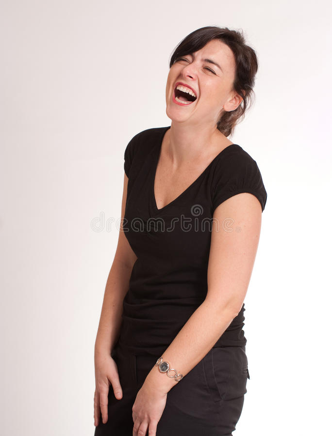 Schallend lachender Brunette lizenzfreie stockbilder
