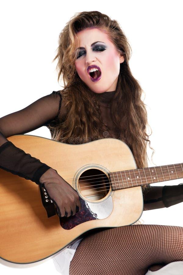 Schalthebelmädchen mit Akustikgitarre lizenzfreies stockbild