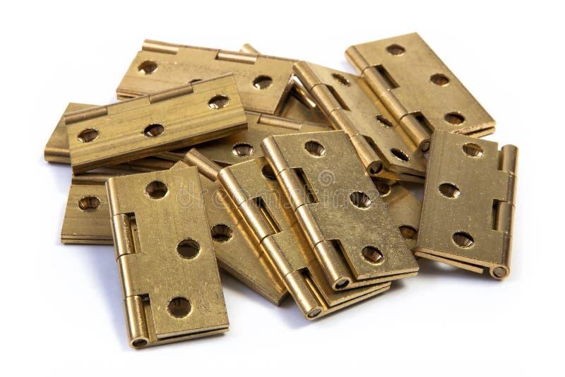 Scharniere für Türen Goldener Messing Auf Weiß lizenzfreie stockfotografie
