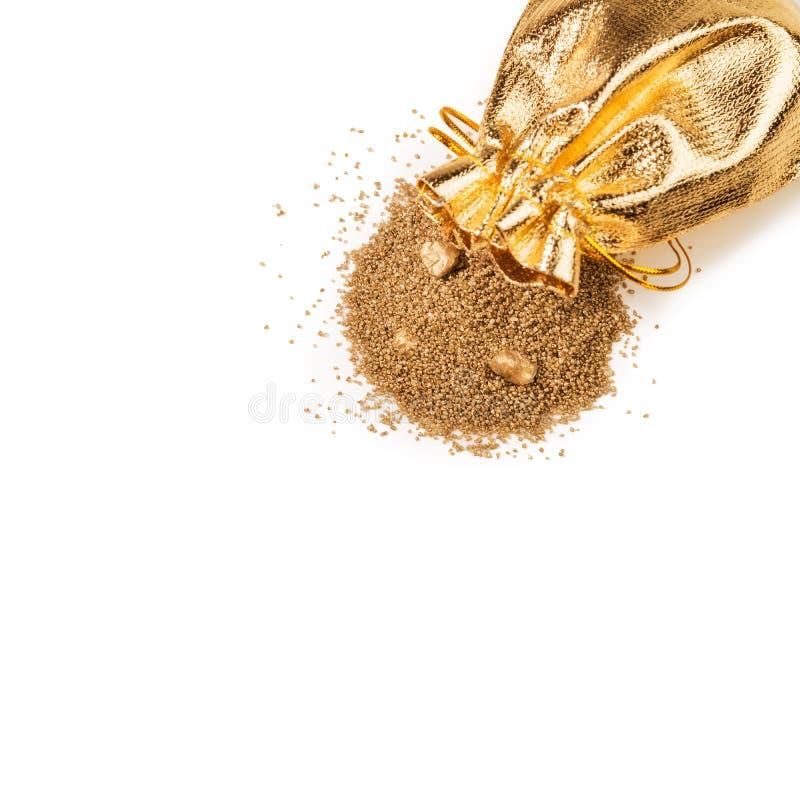 Schatten, gouden zand in zak stock afbeelding