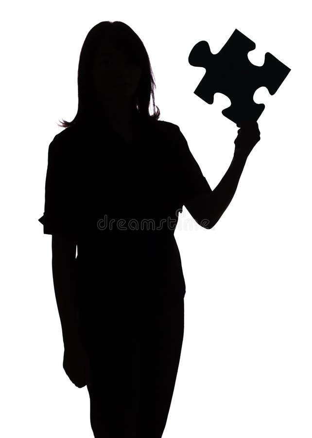 Schattenbild der Frau mit Puzzlespiel lizenzfreies stockbild