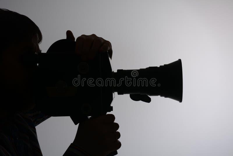 Schattenbild der Mannkameraseite lizenzfreies stockbild