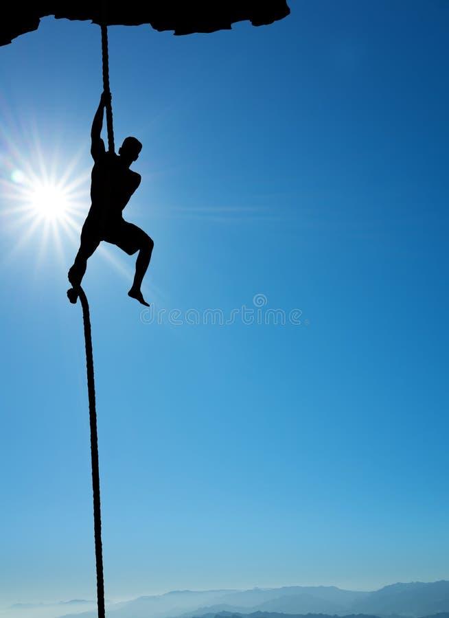 Schattenbild des Kletterervertikalenbildes stockbilder