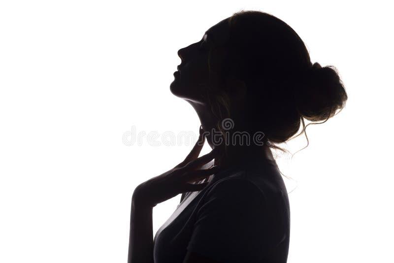 Schattenbild des schönen sinnlichen Mädchens, Frauengesicht profilee auf Weiß lokalisierte Hintergrund, Schönheitsbegriff und Mod stockbild