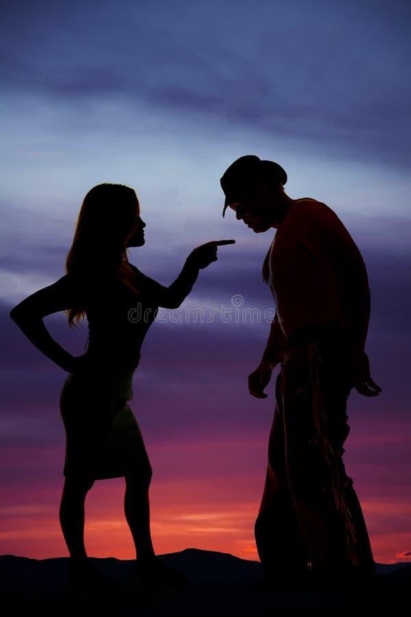 Schattenbild einer Frau im Kleiderpunkt am Cowboy stockfotos