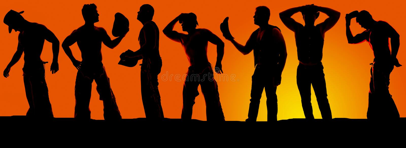Schattenbild einer Gruppe Cowboys im Sonnenuntergang stockfotografie