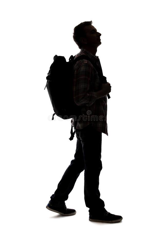 Schattenbild eines m?nnlichen Wanderers oder des Reisef?hrers lizenzfreies stockbild