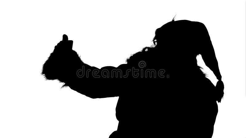 Schattenbild Santa Claus machen das selfie und halten ein großes Geschenk lizenzfreie abbildung