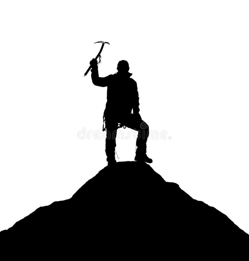 Schattenbild von einem Bergsteiger mit Eisaxt in der Hand lizenzfreie stockfotografie