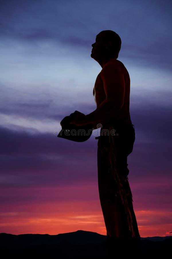 Schattenbildcowboy, den kein Hemdhut weg oben schauen stockfotos