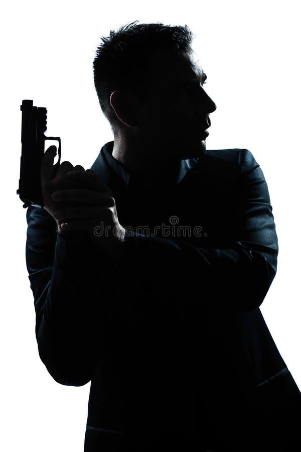 Schattenbildmannportrait mit Gewehr lizenzfreies stockbild