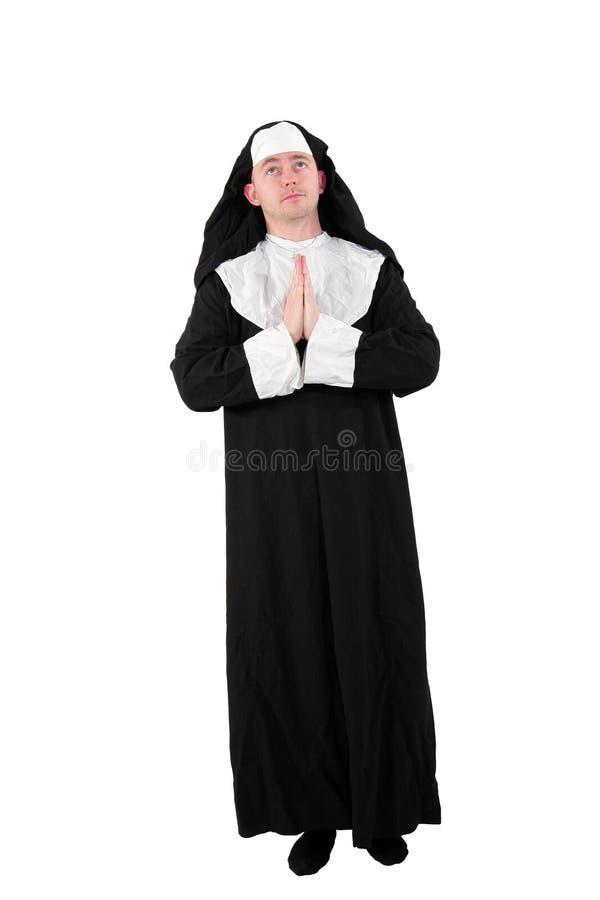 Schauspieler in einem nun´s Kostüm mit den betenden Händen stockfotos