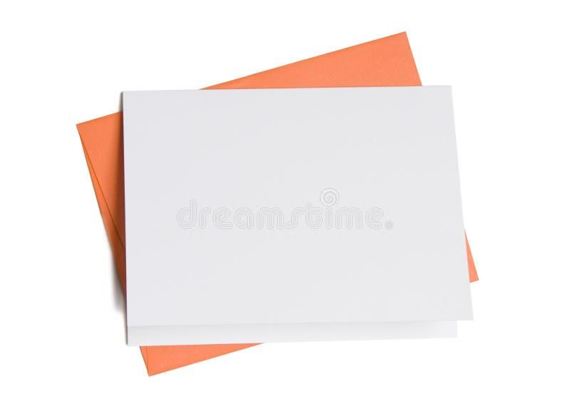 Scheda in bianco con la busta arancione fotografia stock