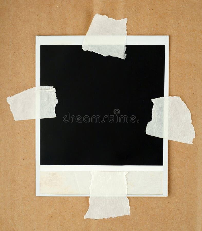Scheda in bianco della foto con il nastro protettivo immagine stock libera da diritti