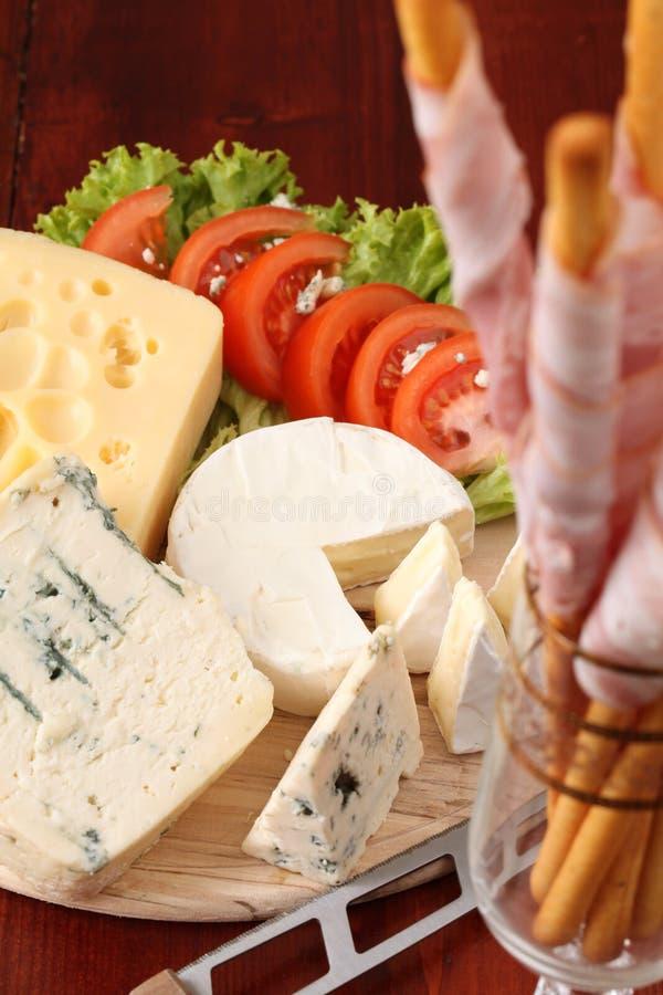 Scheda del formaggio immagine stock libera da diritti