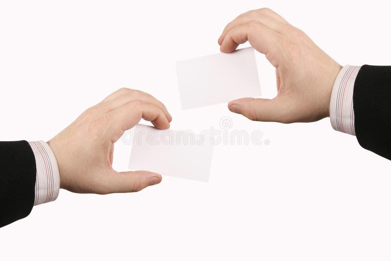 Scheda della holding della mano fotografie stock