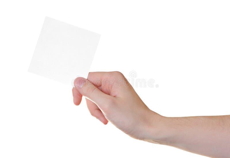 Scheda di carta in mano dell'uomo immagini stock libere da diritti