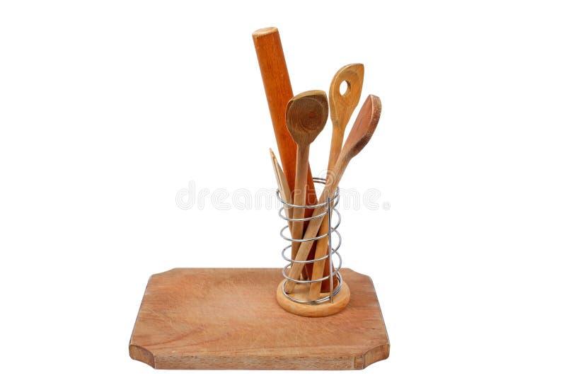 Scheda di legno ed alcuni cucchiai di legno immagini stock libere da diritti