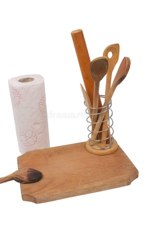Scheda di legno, tovaglioli di carta ed alcuni cucchiai di legno fotografie stock libere da diritti