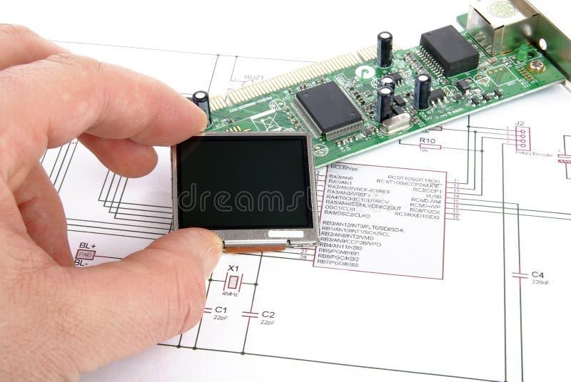 Scheda elettronica con il disegno schematico immagine stock