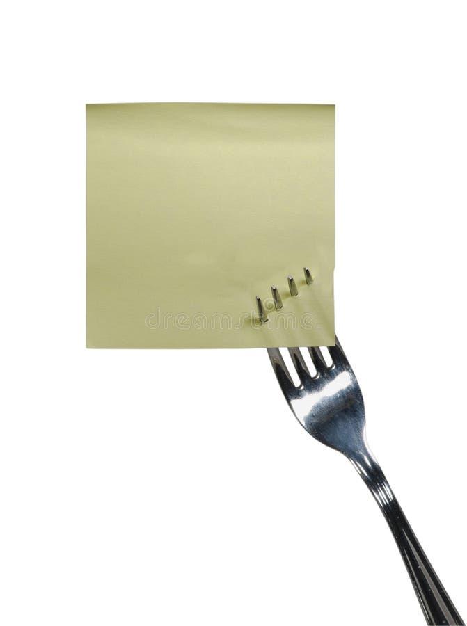 Scheda gialla su una forcella immagine stock
