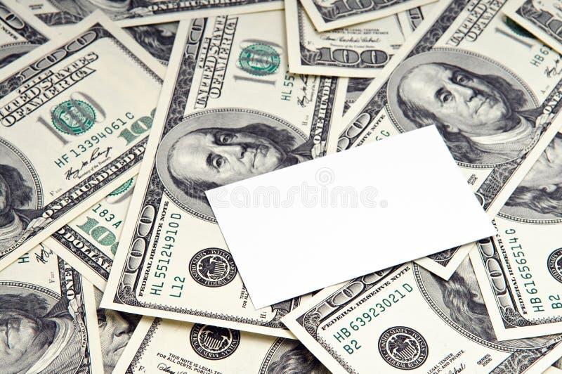 Scheda sopra soldi fotografia stock