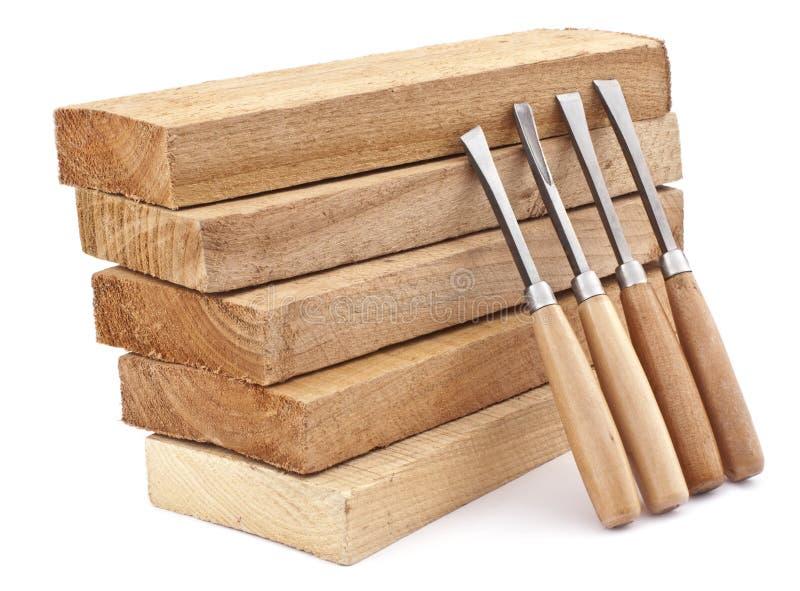 Schede di legno e scalpelli fotografia stock libera da diritti