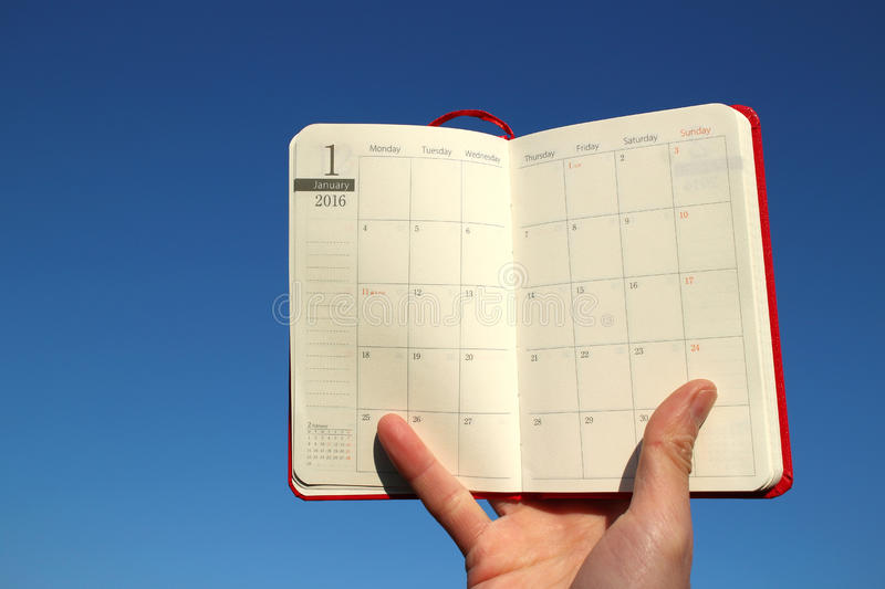 2016 schedule book January page in the blue sky. Background stock photos