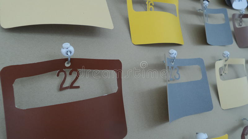 Schedule planner board. Easy made colourful paper schedule planning hanging on board stock images
