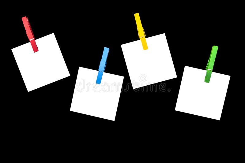 Schedule theme. Blank white paper lists pinned with clothespins isolated on black background. Blank white paper cards hanging with. Clothes pins on black royalty free stock images