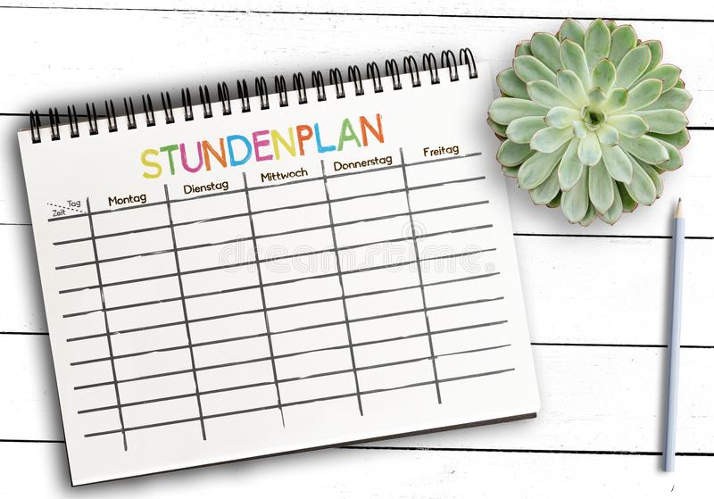 Schedule or timetable template on notepad against rustic white wooden table stock photos