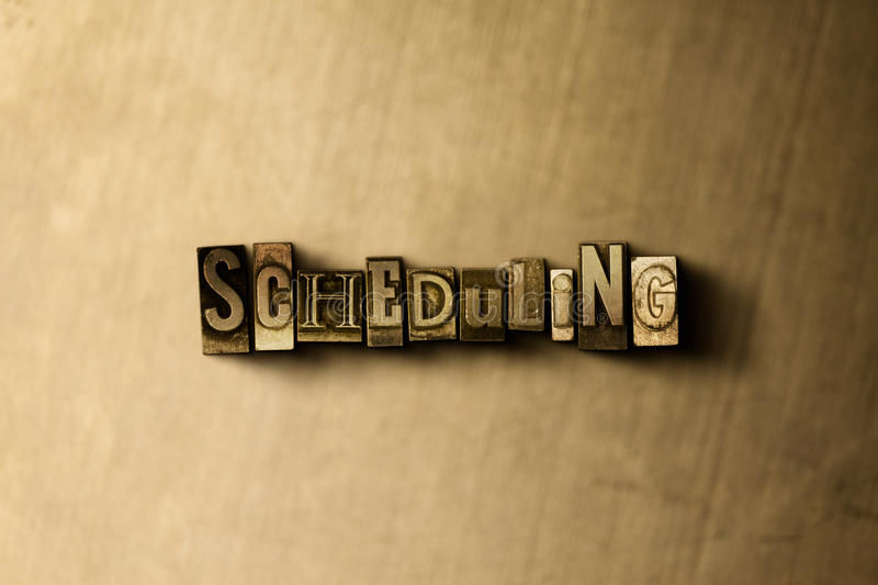 SCHEDULING - close-up of grungy vintage typeset word on metal backdrop stock photos