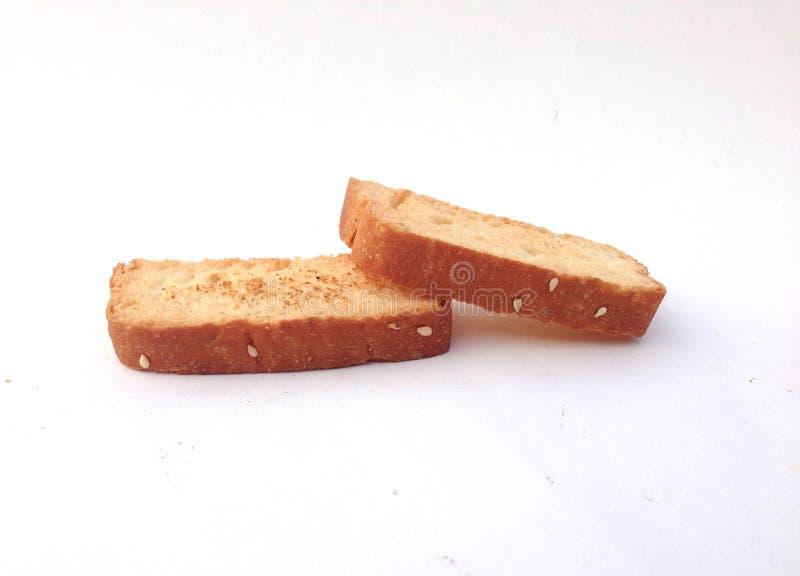 Scheibe des Brotes über dem weißen Hintergrund lizenzfreie stockbilder