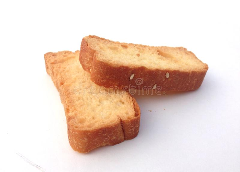 Scheibe des Brotes über dem weißen Hintergrund stockfotos