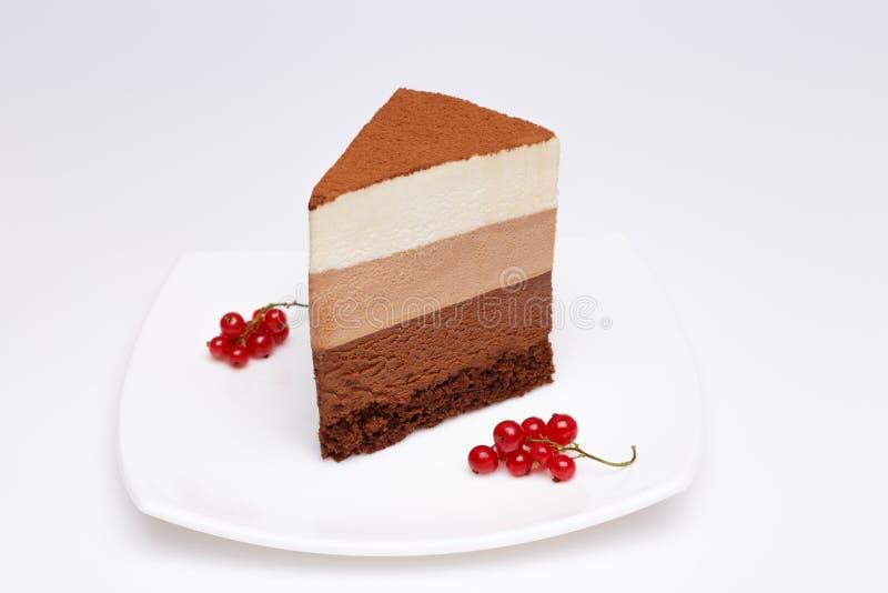 Scheibe des drei Schokoladencremekuchens stockfotos