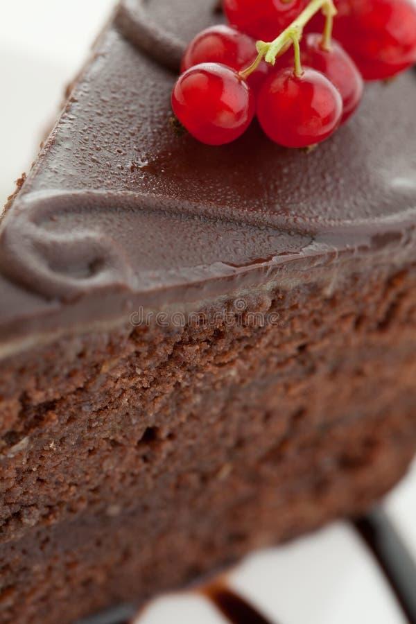 Scheibe des köstlichen Schokoladenkuchens stockbilder
