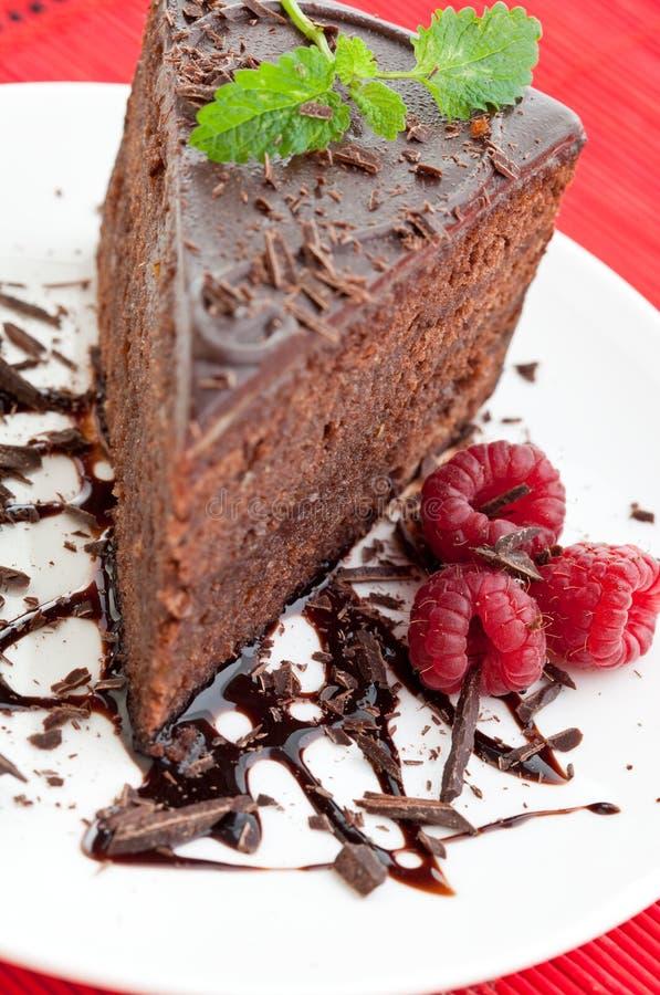 Scheibe des köstlichen Schokoladenkuchens lizenzfreies stockfoto