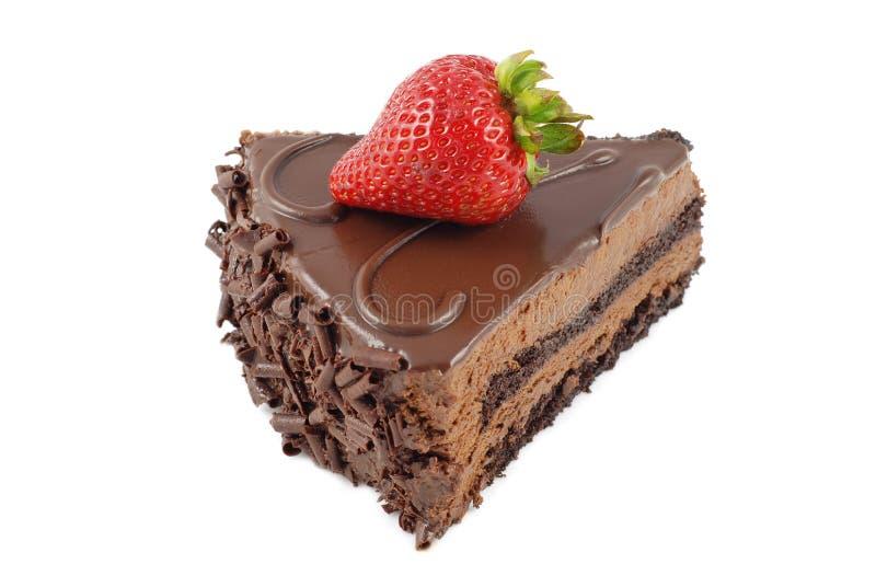 Scheibe des Schokoladenkuchens mit Erdbeere lizenzfreie stockbilder