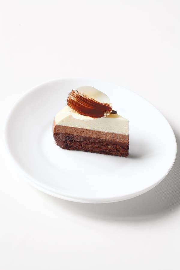 Scheibe Schokoladencreme-des Kuchens des Zeitgenosse-drei stockfoto