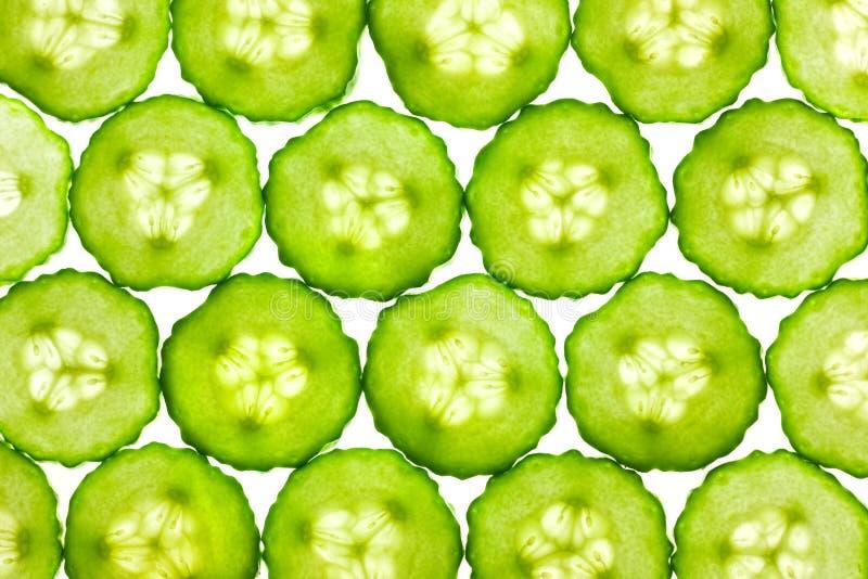 Scheiben der frischen Gurke/des Hintergrundes/des rückseitigen beleuchtet lizenzfreie stockfotografie