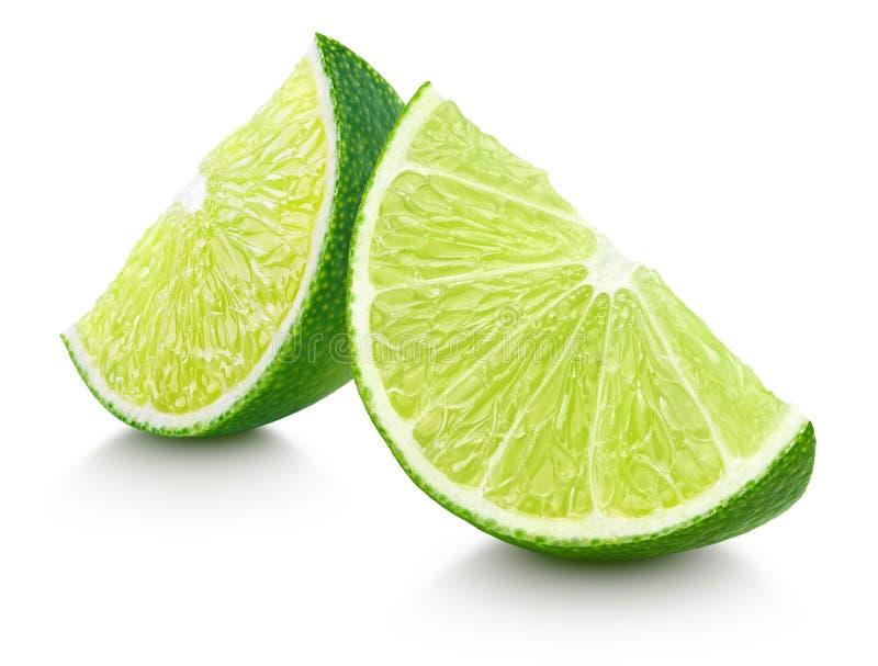 Scheiben der KalkZitrusfrucht lokalisiert auf Weiß lizenzfreie stockfotos