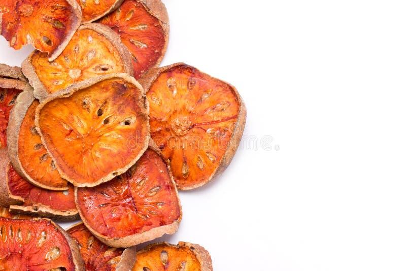 Scheiben getrockneter Bael-Frucht. lizenzfreie stockfotografie