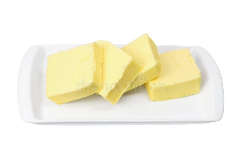 Scheiben von Butter auf Platte stockbild