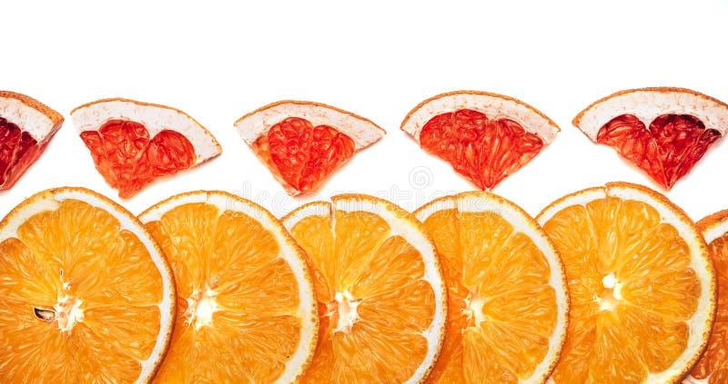 Scheiben von Orangen und Grapefruits lizenzfreies stockfoto