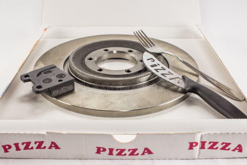Scheibenbremsen und Pizza stockbild